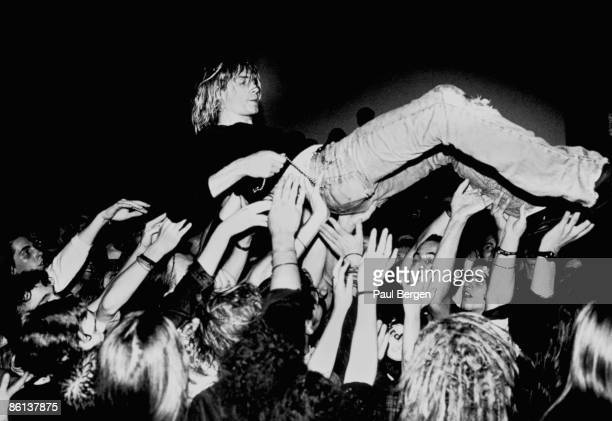 Photo of Kurt COBAIN and NIRVANA and CROWD SURFING Kurt Cobain performing live crowd surfing