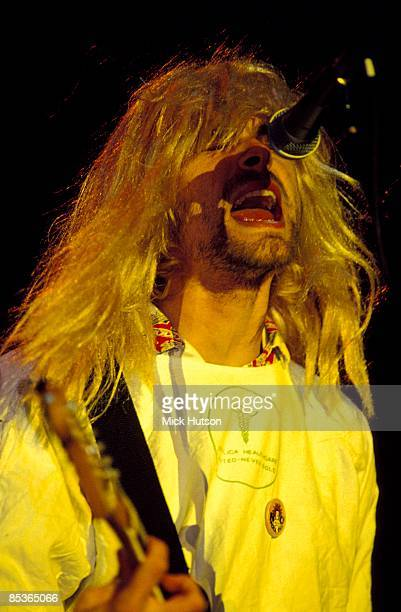 FESTIVAL Photo of Kurt COBAIN and NIRVANA Kurt Cobain performing live onstage wearing wig