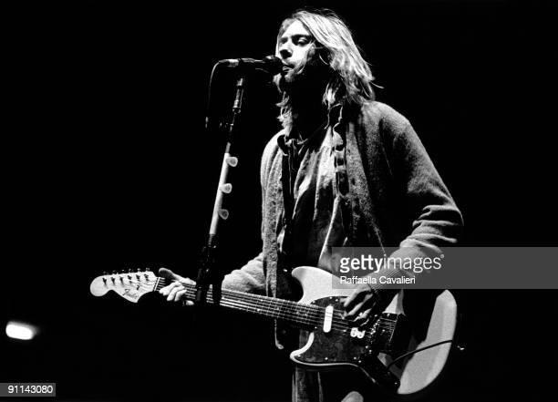 Photo of Kurt COBAIN and NIRVANA Kurt Cobain performing live onstage at Palasport Modena playing Fender Mustang guitar
