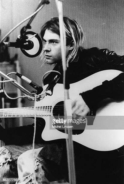 HILVERSUM Photo of Kurt COBAIN and NIRVANA Kurt Cobain recording in Hilversum Studios playing acoustic guitar
