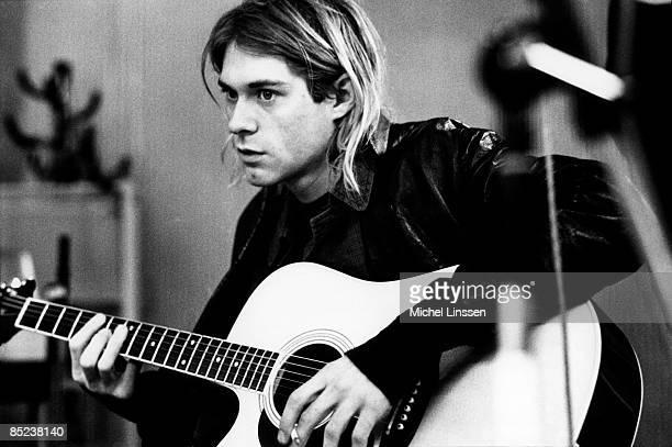 HILVERSUM Photo of Kurt COBAIN and NIRVANA Kurt Cobain recording in Hilversum Studios playing Takamine acoustic guitar
