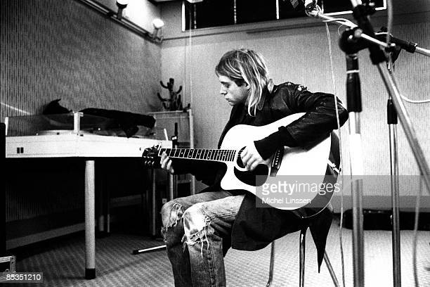 HILVERSUM Photo of Kurt COBAIN and NIRVANA Kurt Cobain recording in Hilversum studios playing acoustic guitar