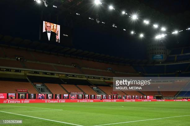Photo of late Italian composer Ennio Morricone is displayed in his homage prior to the Italian Serie A football match AC Milan vs Juventus played...