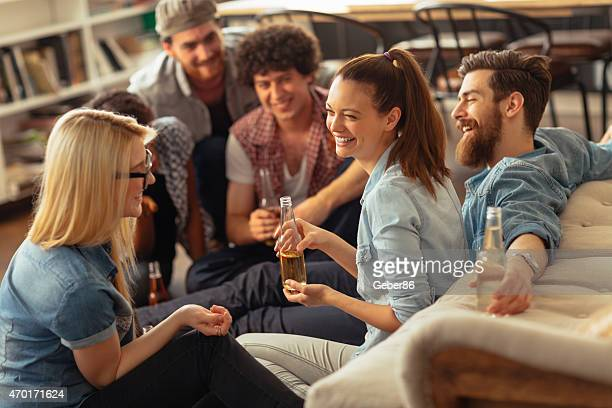 Photo of laughing friends enjoying beer and hanging out