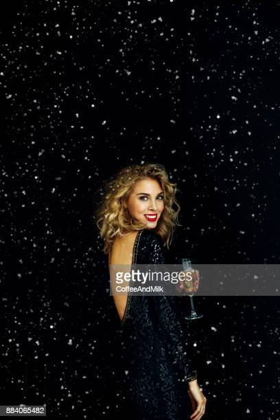 photo of laughing girl strewn snow - cocktail dress stock pictures, royalty-free photos & images