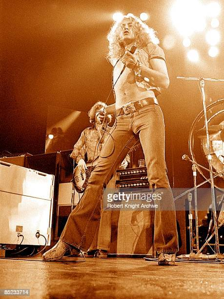 Photo of LED ZEPPELIN and Robert PLANT Robert Plant with John Paul Jones behind performing live onstage