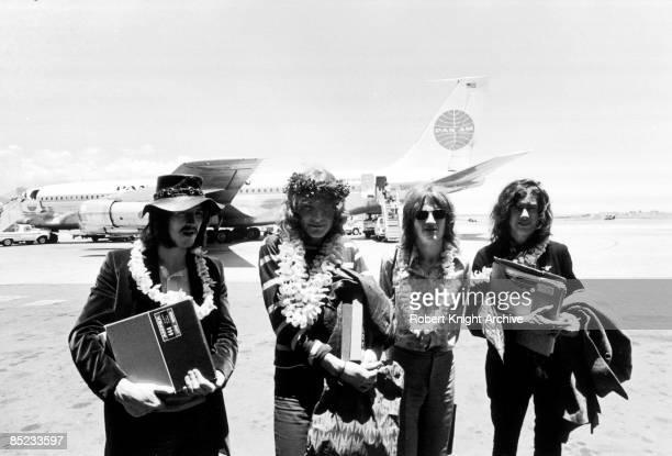 HONOLULU Photo of LED ZEPPELIN LR John Bonham Robert Plant John Paul Jones Jimmy Page group shot posed arriving at Honolulu Airport holding Led...