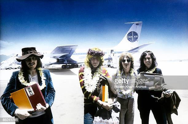 HONOLULU Photo of LED ZEPPELIN LR John Bonham Robert Plant John Paul Jones Jimmy Page group shot posed arriving at Honolulu Airport holding Led...