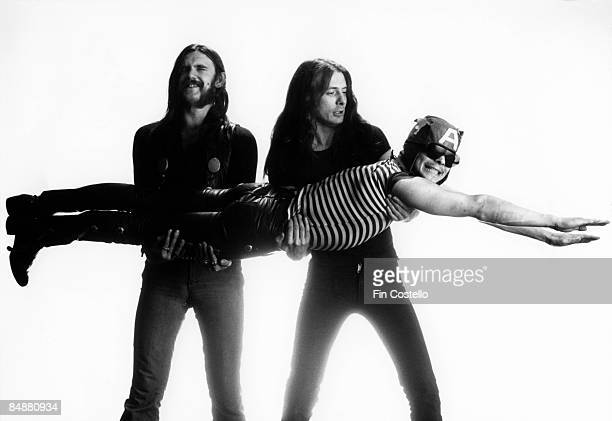 Photo of LEMMY and MOTORHEAD Lemmy Fast Eddie Clark carrying Phil Taylor