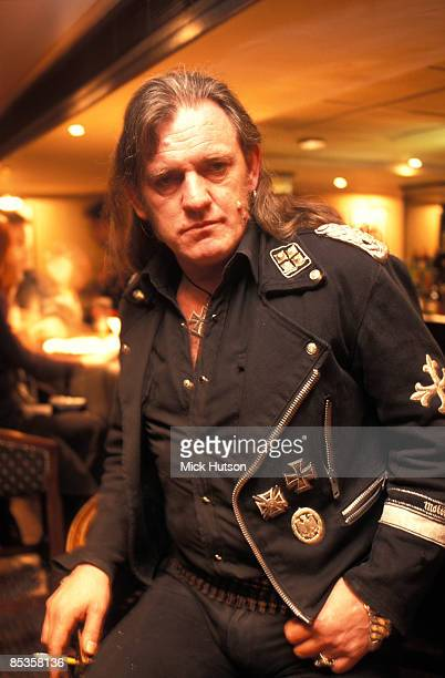 Photo of LEMMY and MOTORHEAD Lemmy sat at the bar in a hotel