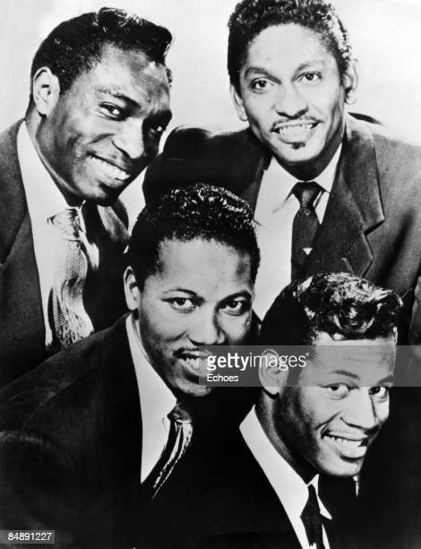 STUDIO Photo of Leon HUGHES and Carl GARDNER and Bobby NUNN and COASTERS and Billy GUY Posed studio group portrait LR Bobby Nunn Leon Hughes Carl...