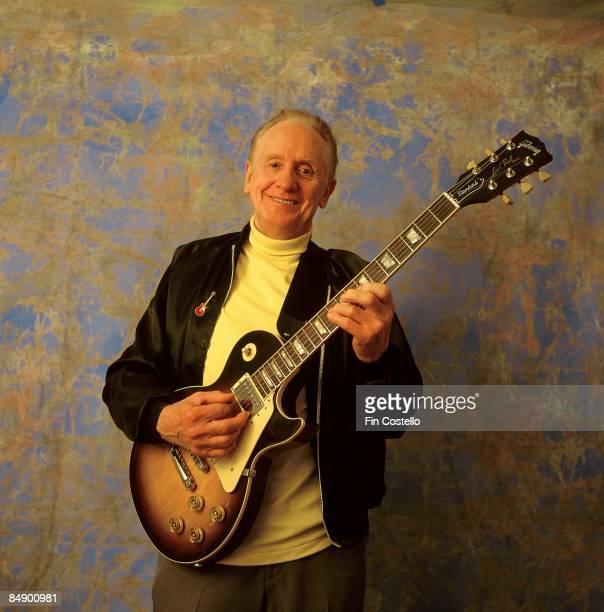 Photo of Les PAUL posed studio playing Gibson Les Paul guitar