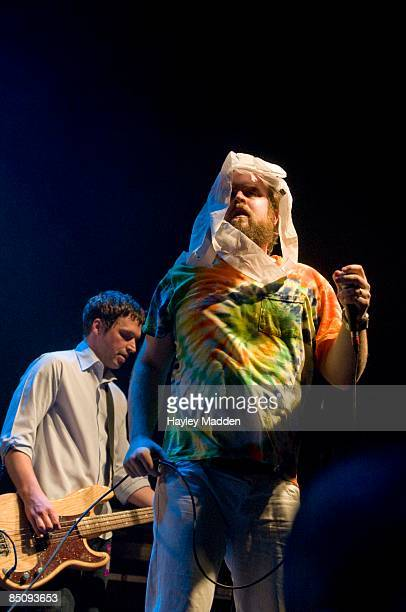ASTORIA Photo of LES SAVY FAV and Tim HARRINGTON Tim Harrington with Syd Butler behind performing live onstage on the NME Brats Tour 2008 with toilet...