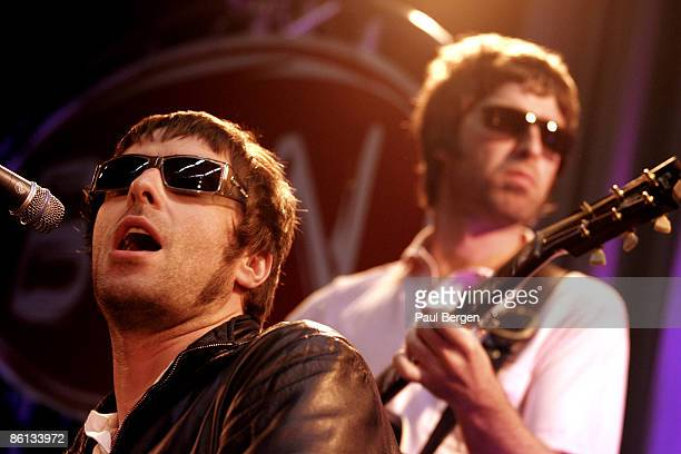 Photo of Liam GALLAGHER and Noel GALLAGHER and OASIS Liam Gallagher Noel Gallagher performing live onstage
