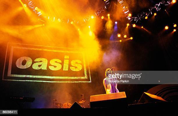 KNEBWORTH Photo of Liam GALLAGHER and OASIS Liam Gallagher performing live onstage with Oasis logo behind