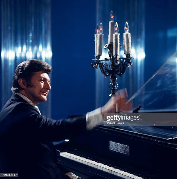 Photo of LIBERACE Liberace performing on tv show candles