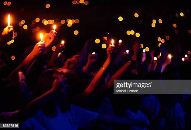 Photo of LIGHTERS and LIGHT SHOWS Cagarette lights being held in the air at a rock concert in The Netherlands circa 1990