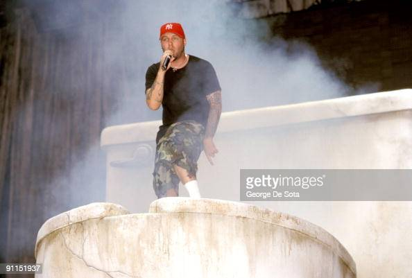 photo of limp bizkit  fred durst climbing out of a giant
