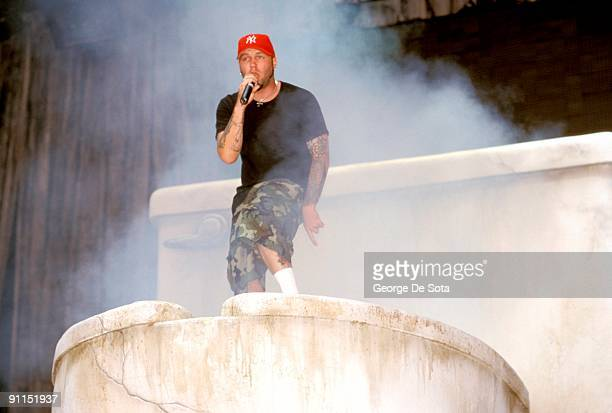 Photo of LIMP BIZKIT Fred Durst climbing out of a giant toilet 'prop' at Ozzfest Photo by George De Sota /Redferns