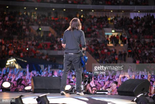 STADIUM Photo of LIVE EARTH CONCERT and Dave GROHL and FOO FIGHTERS Dave Grohl performing live onstage at Live Earth concert view from stage with...