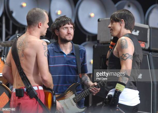 Photo of LIVE EARTH CONCERT and John FRUSCIANTE and FLEA and RED HOT CHILI PEPPERS Flea John Frusciante and Anthony Kiedis performing live onstage at...