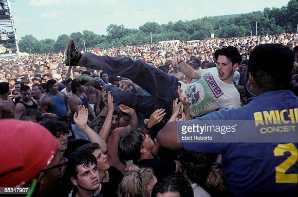 Photo of LOLLAPALOOZA, Fans crowd surfing at the Lollapalooza concert in Waterloo Village, New Jersey August 14th, 1991