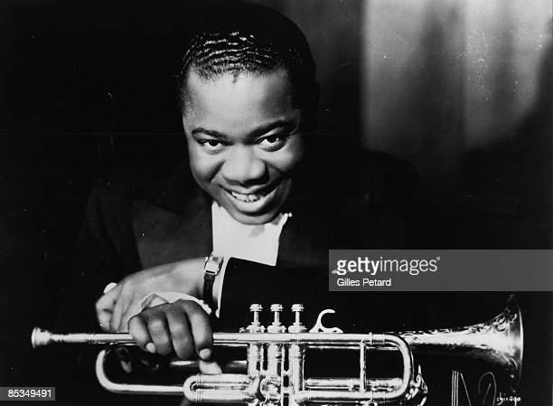 Photo of Louis ARMSTRONG Posed portrait of Louis Armstrong with trumpet