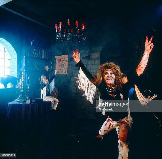 Photo of Louis OSBOURNE and Ozzy OSBOURNE with his son Louis Osbourne in the background dressed as him wearing ripped clothes and zombie make up...