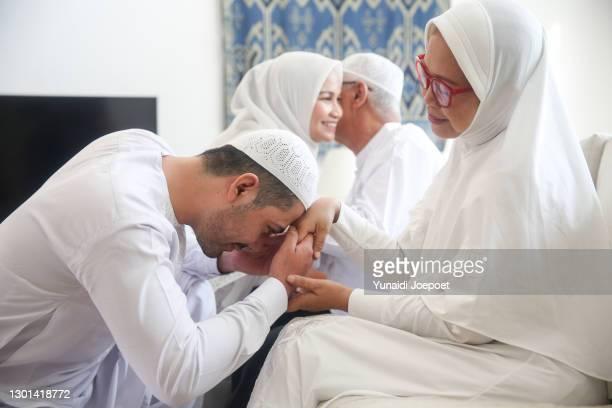 photo of lovely family celebrating hari raya idul fitri, eid mubarak - religion stock pictures, royalty-free photos & images