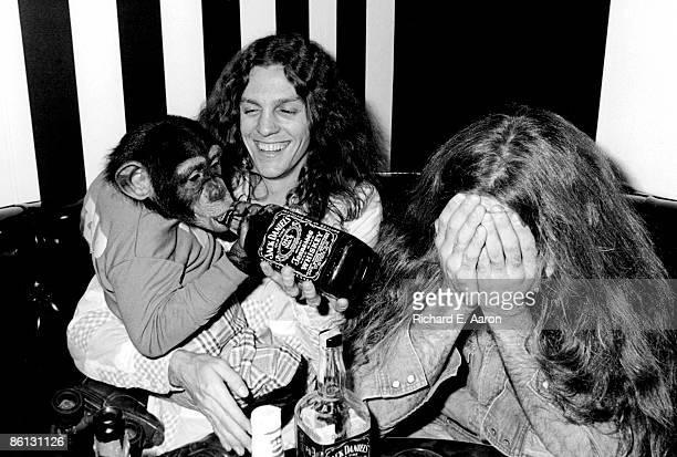 NATHANS Photo of LYNYRD SKYNYRD and Gary ROSSINGTON Gary Rossington backstage chimp drinking Jack Daniels animal pet drink