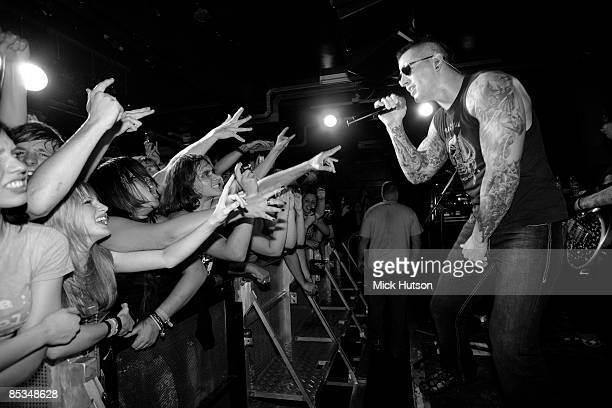CLUB Photo of M SHADOWS and AVENGED SEVENFOLD M Shadows performing live onstage fans reaching out from audience