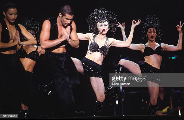Photo of MADONNA, Madonna performing on stage - Girlie Show tour