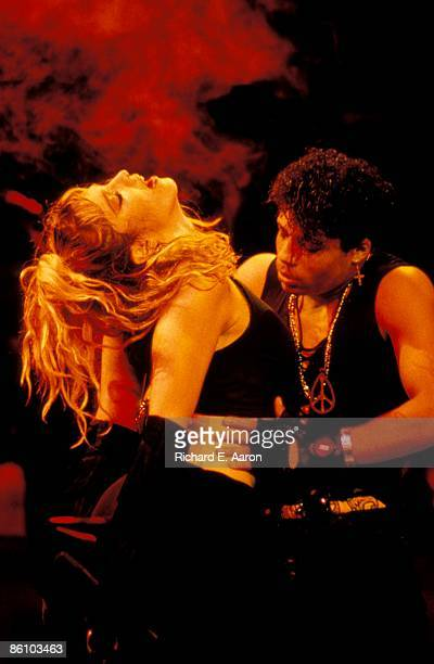 Photo of MADONNA Madonna performing on stage Virgin tour with male dancer