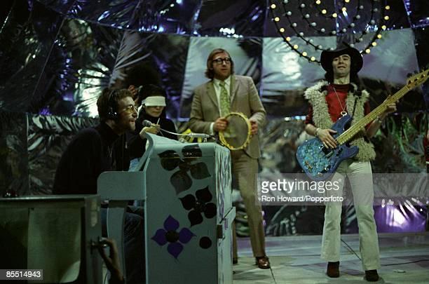 POPS Photo of Mal EVANS and John LENNON LR John Lennon Yoko Ono Mal Evans on tambourine Klaus Voorman performing Instant Karma