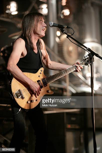 Photo of Malcolm YOUNG and AC DC and AC/DC Malcolm Young on the set of the video for 'Rock 'n' Roll Train'