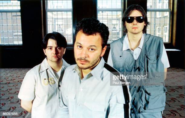 Photo of MANIC STREET PREACHERS LR Sean Moore James Dean Bradfield Nicky Wire posed group shot