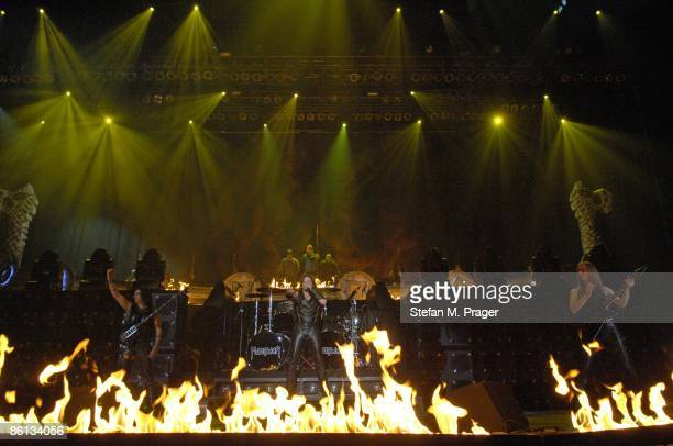 OLYMPIAHALLE Photo of MANOWAR and Joey DeMAIO and Eric ADAMS and Karl LOGAN LR Joey DeMaio Eric Adams and Karl Logan performing on stage fire