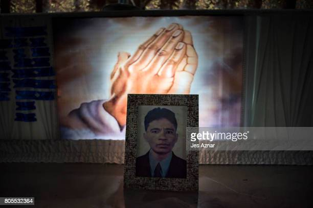 A photo of Manuel Borbe on top of his coffin on June 28 2017 in Quezon city Philippines Borbe was standing on a street near his house when...