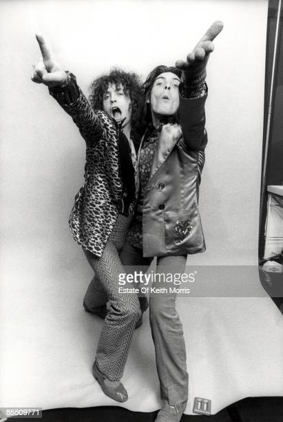 Photo of Marc BOLAN and T REX and Mickey FINN; studio, posed with Mickey Finn