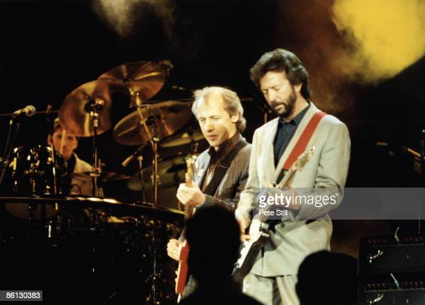 Photo of Mark KNOPFLER and DIRE STRAITS and Eric CLAPTON Mark Knopfler and Eric Clapton performing on stage at the Nelson Mandela 70th Birthday...
