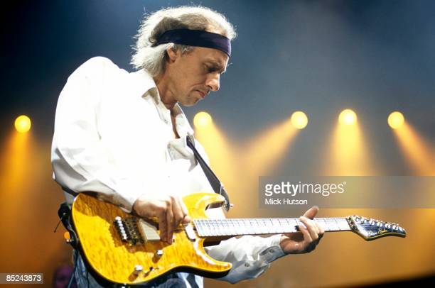 ARENA Photo of Mark KNOPFLER and DIRE STRAITS Mark Knopfler performing live onstage playing Pensa guitar wearing headband