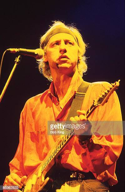 Photo of Mark KNOPFLER and DIRE STRAITS Mark Knopfler performing live onstage wearing headband