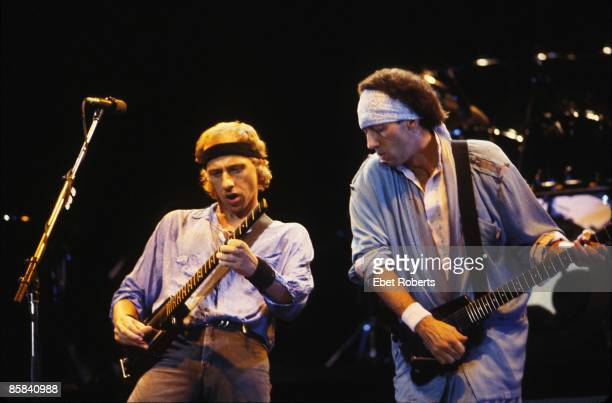 UNITED STATES JANUARY 01 Photo of Mark KNOPFLER and Jack SONNI and DIRE STRAITS Mark Knopfler and Jack Sonni performing live onstage playing...