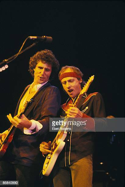 UNITED STATES JANUARY 01 Photo of Mark KNOPFLER and John ILLSLEY and DIRE STRAITS John Illsley and Mark Knopfler performing live onstage