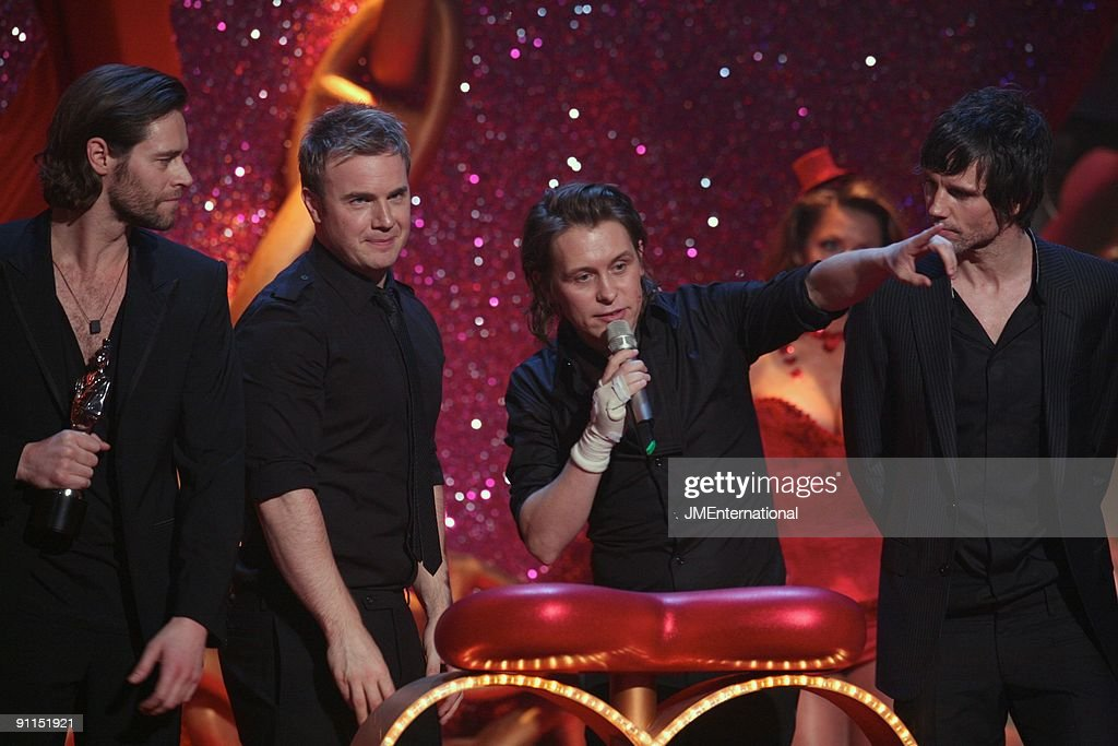 Photo of Mark OWEN and Gary BARLOW and Howard DONALD and TAKE THAT; L-R: Howard Donald, Gary Barlow, Mark Owen, Jason Orange collecting the award for Best British Single (for the song 'Patience') at the 2007 Brit Awards at Earls Court
