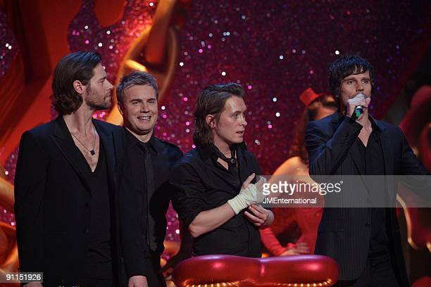 Photo of Mark OWEN and Gary BARLOW and Howard DONALD and TAKE THAT LR Howard Donald Gary Barlow Mark Owen Jason Orange collecting the award for Best...