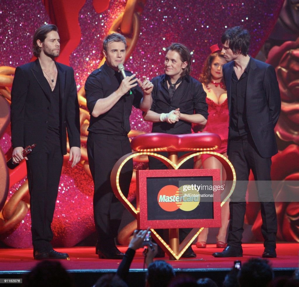 Photo of Mark OWEN and Gary BARLOW and Howard DONALD and TAKE THAT; L-R: Howard Donald, Gary Barlow, Mark Owen, Jason Orange collecting their award for Best British Single (for the song 'Patience') at the 2007 Brit Awards at Earls Court
