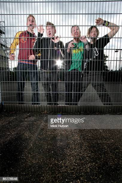 Photo of MASTODON and Troy SANDERS and Bill KELLIHER and Brann DAILOR and Brent HINDS LR Brann Dailor Bill Kelliher Brent Hinds Troy Sanders posed...