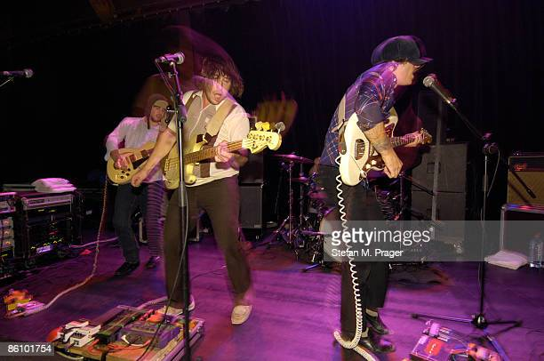 Photo of Matt MOORE and Zach BROTHERS and John GOURLEY and PORTUGAL THE MAN Performing live onstage L R Matt Moore Zach Brothers John Gourley