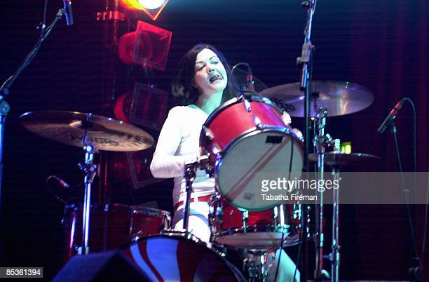 ACADEMY Photo of Meg WHITE and WHITE STRIPES Meg White performing on stage